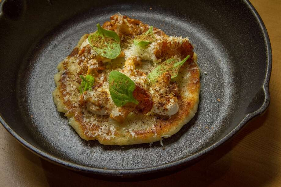 The Arepa with cave aged cheese and Hedgehog Mushrooms at TBD. Photo: John Storey, Special To The Chronicle