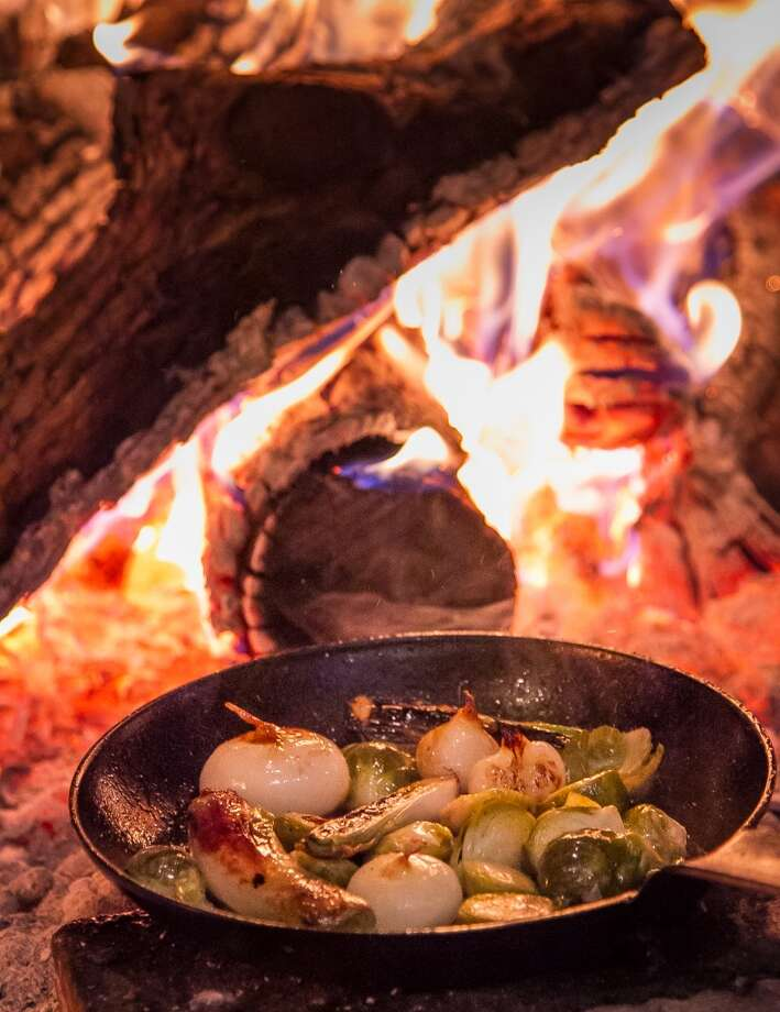 Vegetables for the Ribeye cook in the fire at TBD. Photo: John Storey, Special To The Chronicle