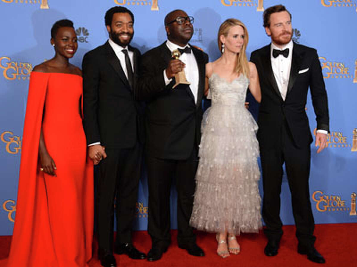 From left, Lupita Nyong'o, Chiwetel Ejiofor, Steve McQueen, Sarah Paulson, and Michael Fassbender pose in the press room with the award for best motion picture - drama for