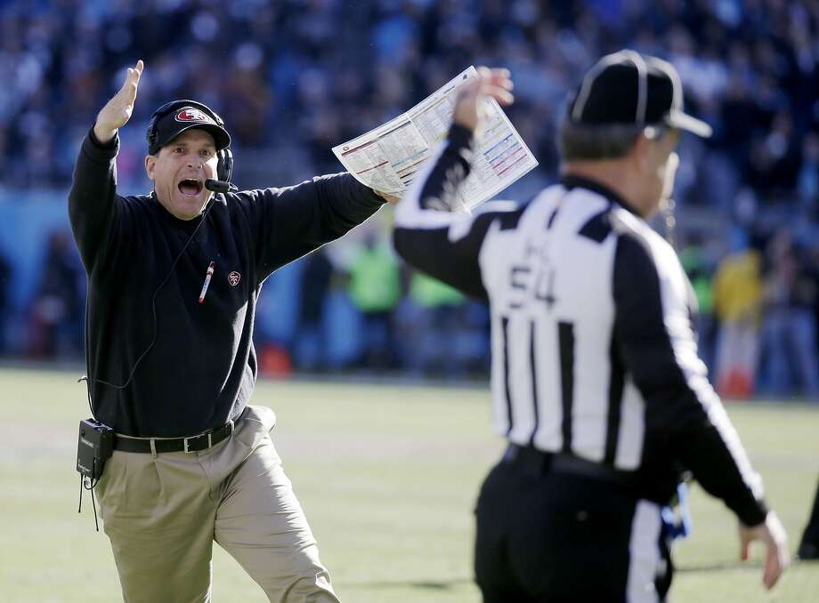San Francisco 49ers head coach Jim Harbaugh reacts to a a call at the end of the first half against the Carolina Panthers during the first half of a divisional playoff NFL football game, Sunday, Jan. 12, 2014, in Charlotte, N.C. Photo: John Bazemore, Associated Press
