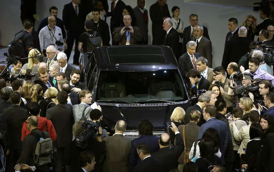 Journalists surround the new F-150 with a body built almost entirely out of aluminum. Photo: Carlos Osorio, Associated Press