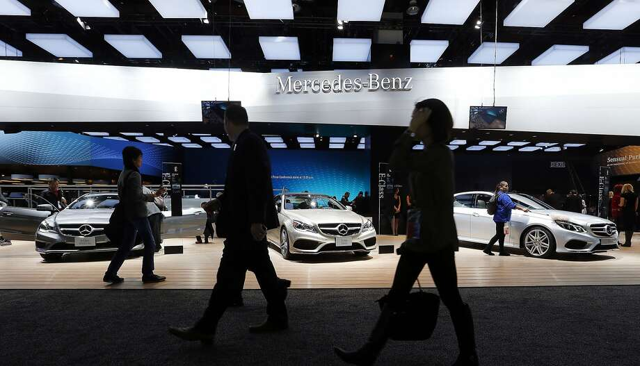 Journalists walk past the Mercedes-Benz during media previews in Detroit. Photo: Paul Sancya, Associated Press