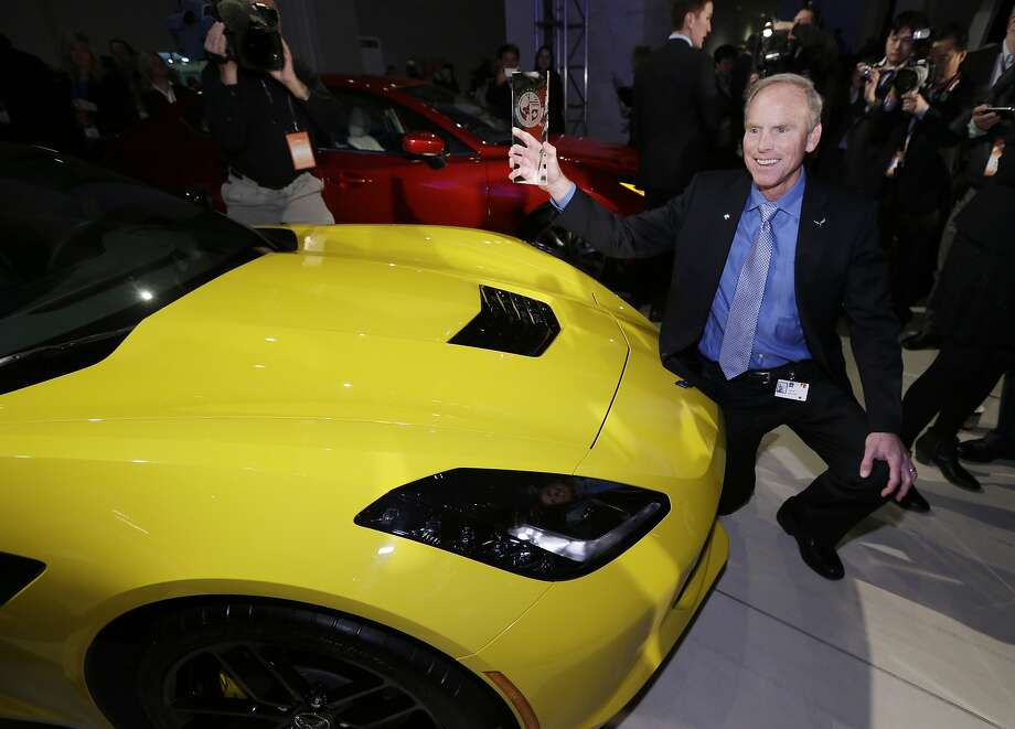 Chevrolet Corvette Stingray chief engineer Tadge Juechter holds up the North American Car of the Year award. Photo: Carlos Osorio, Associated Press