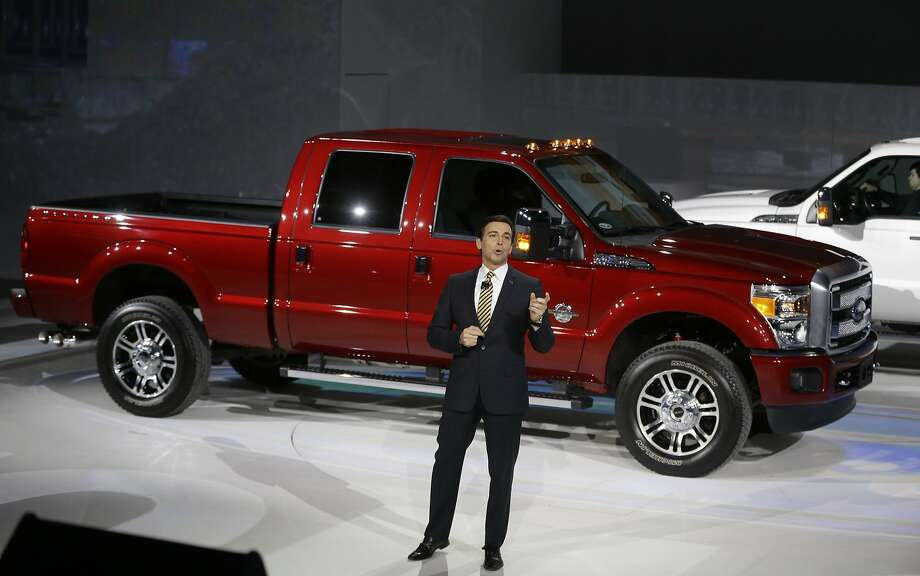 Ford Motor Co., COO Mark Fields stand next to the new Ford F-150 truck. Photo: Carlos Osorio, Associated Press