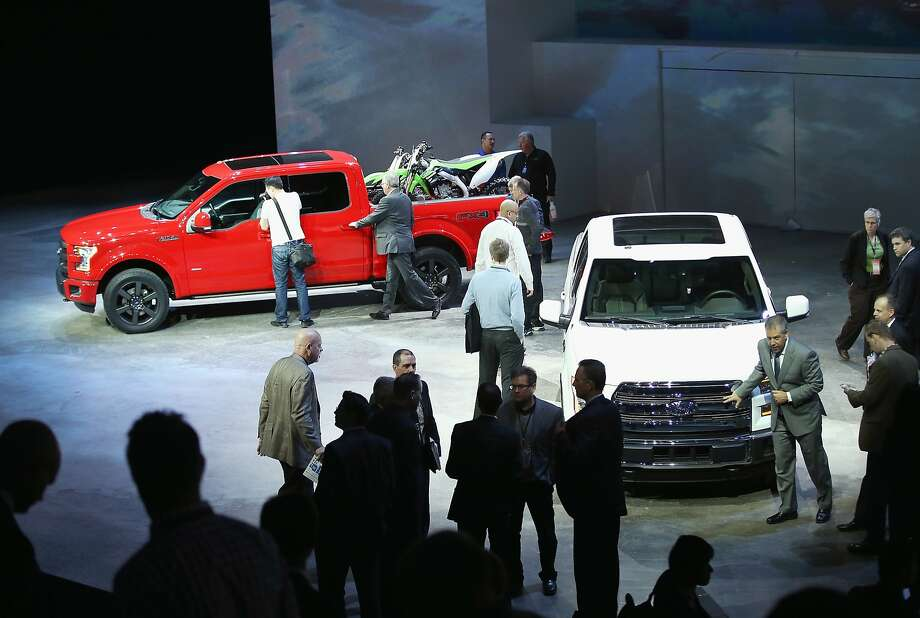 Members of the media look over the Ford F-150 pickup truck after its introduction. Photo: Scott Olson, Getty Images