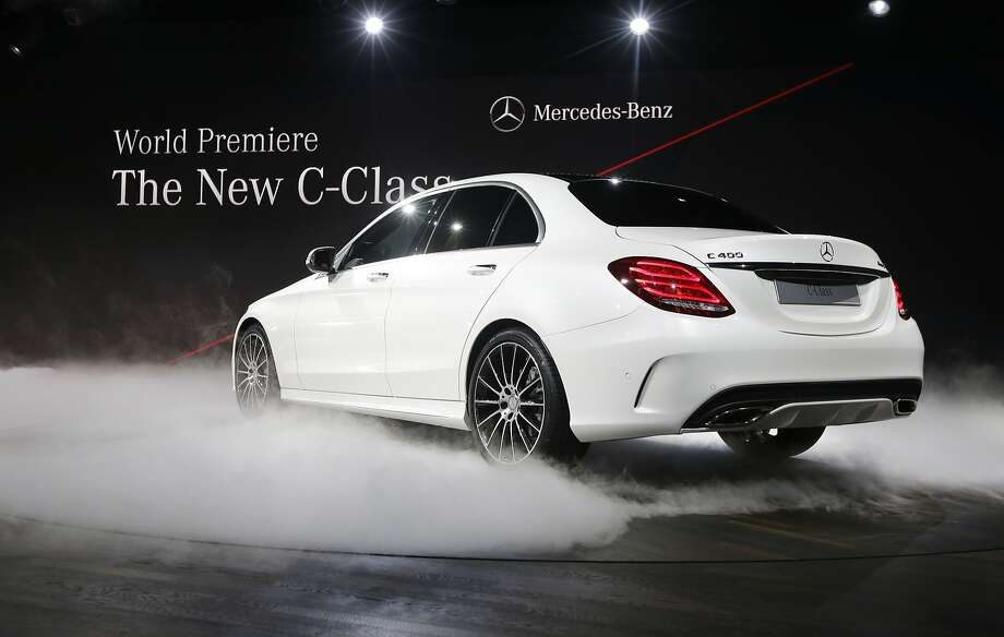 Mercedes Benz unveils the new C-Class car during a preview night for the North American International Auto Show. Photo: Carlos Osorio, Associated Press