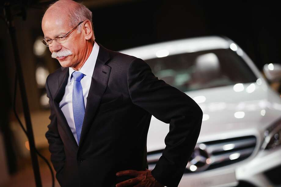 Dr. Dieiter Zetsche Chairman of the Board at Mercedes-Benz speaks to a reporter in front of a 2015 C Class. Photo: Scott Olson, Getty Images