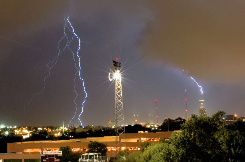 Lightning strikes downtown San Antonio and the Tower of the Americas during storms that rolled through the area Sunday Sept. 17, 2006. The scene was photographed from a dorm room balcony at Trintiy University. SEAN KIENLE / COURTESY Storms on Sunday Sept. 17 brought lightening with them as they rolled through San Antonio. Trinity University. This evening I was shooting pictures from my balcony and just happened to capture an image of the Tower of Americas being struck by lightning