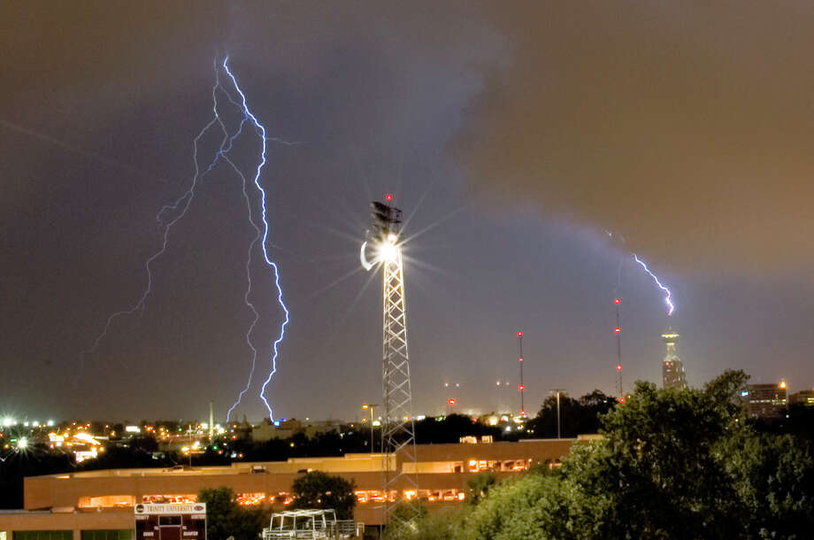 Lightning strikes the Tower of the Americas during storms that rolled through the area Sunday Sept. 17, 2006. Photo: COURTESY SEAN KIENLE