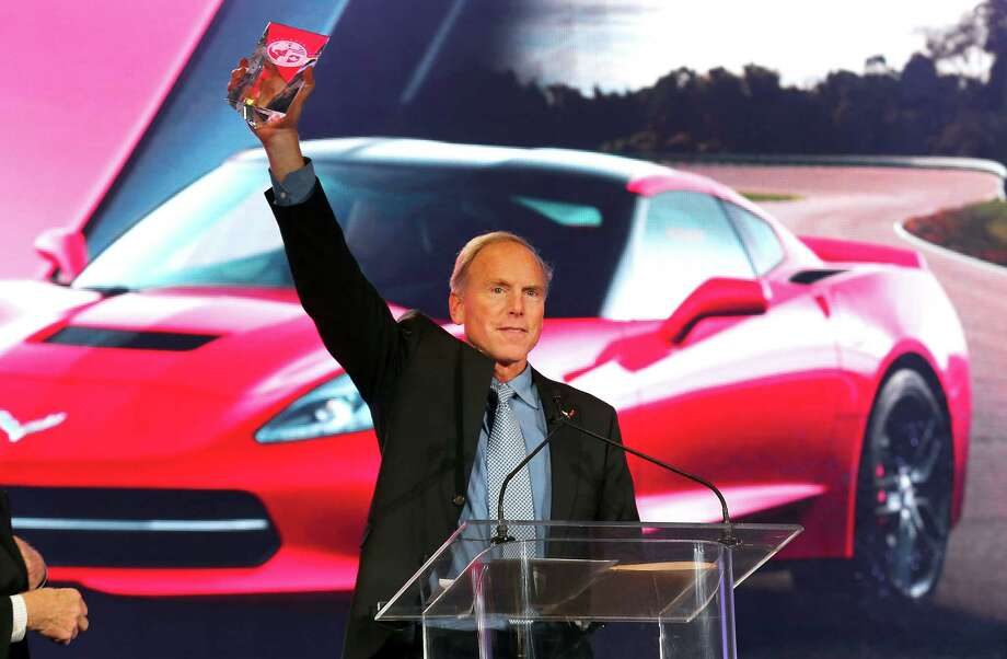 Chevrolet Corvette Stingray chief engineer Tadge Juechter holds up the North American Car of the Year award at the North American International Auto Show in Detroit, Monday, Jan. 13, 2014. Photo: Paul Sancya, AP / AP