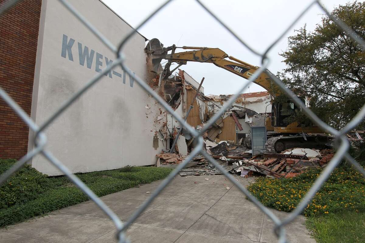 Demolition begins on the KWEX 41 Univision building, 411 E. Cesar E. Chavez Boulevard, on Nov. 4, 2013. The building was demolished to make room for a 350-unit apartment complex on the prime River Walk real estate.