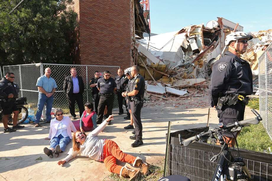 Protesters block access for a water truck in an attempt to stop the complete demolition at the former Univision building Nov. 12, 2013. Photo: Jerry Lara, Express-News