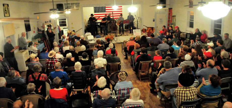 On opening night Friday, the County Seat Music Hall filled its space with guests who braved the rain to attend the first show in the 1946 building at 125 West Brown St. The 4,500-square-foot structure, World War II-era dance hall, was renovated over the past year by the Hardin County Genealogical Society. Photo by Cassie Smith/@smithcassie. Jan. 10, 2014. Photo: Cassie Smith