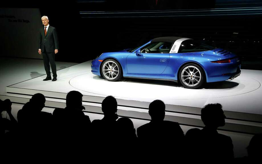 Matthias Muller, President and CEO, R. Ing. h.c. F. Porsche AG introduces the Porsche 911 Targa during media previews during the North American International Auto Show in Detroit, Monday, Jan. 13, 2014. Photo: Paul Sancya, AP / AP