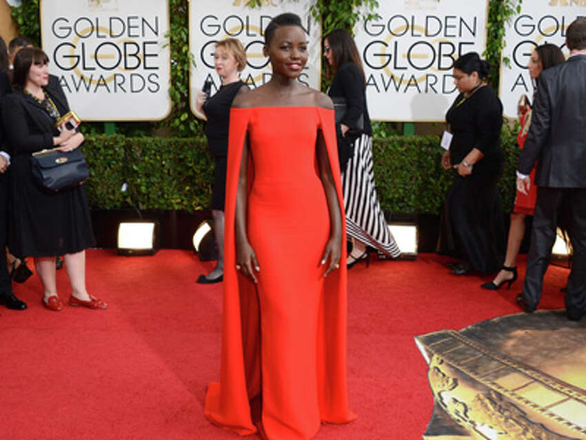 Lupita Nyong'o arrives at the 71st annual Golden Globe Awards at the Beverly Hilton Hotel on Sunday, Jan. 12, 2014, in Beverly Hills, Calif.