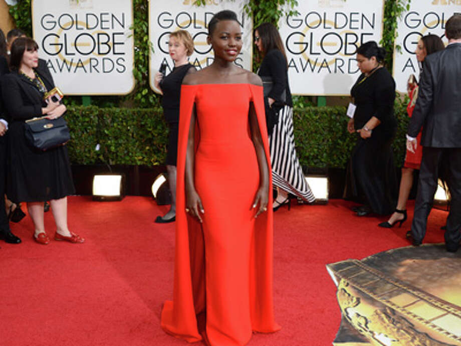 Lupita Nyong'o arrives at the 71st annual Golden Globe Awards at the Beverly Hilton Hotel on Sunday, Jan. 12, 2014, in Beverly Hills, Calif. Photo: Jordan Strauss, Jordan Strauss/Invision/AP / Invision