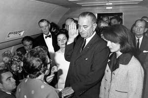 Judge Sarah T. Hughes administers the Presidential Oath of Office to Lyndon Baines Johnson around 2:40 p.m. (CT) aboard Air Force One at Love Field in Dallas. Mrs. Johnson, Mrs. Kennedy, Jack Valenti, Rep. Albert Thomas, Rep. Jack Brooks, Associate Press Secretary Malcolm Kilduff (holding microphone) and others witness the oath.