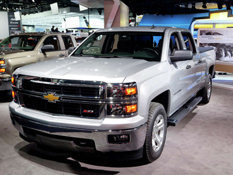 The Chevrolet Silverado has been named North American Truck of the Year at the North American International Auto Show, while the Chevrolet Corvette Stingray has been named North American Car of the Year at the North American International Auto Show in Detroit, Monday, Jan. 13, 2014. Photo: Paul Sancya, AP / AP