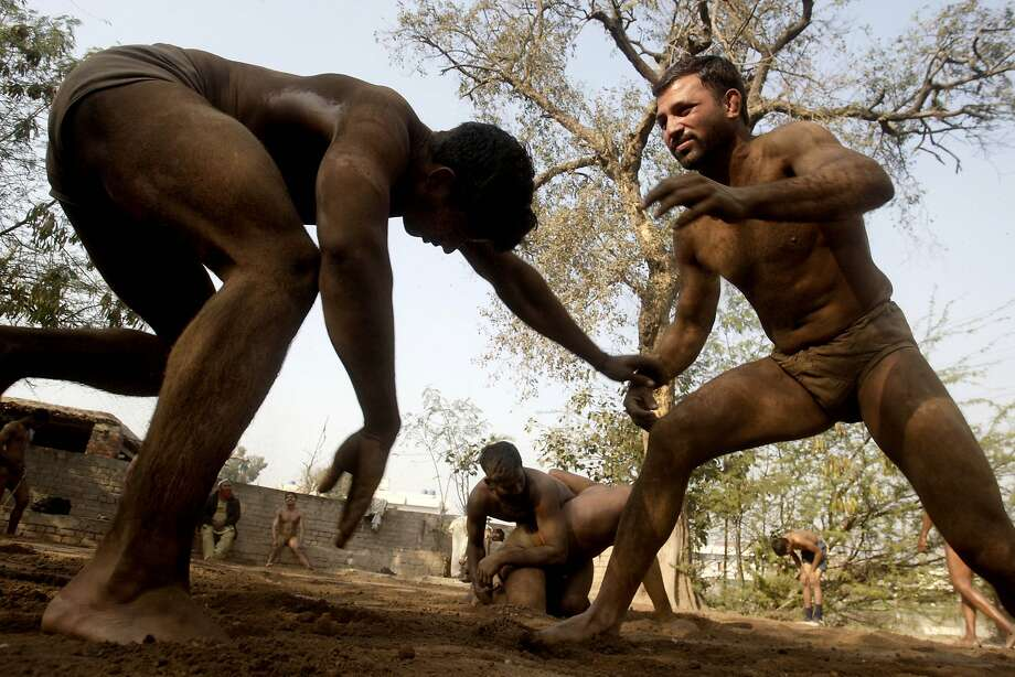 Nothing fake about it: Kushti wrestlers train in the dirt in Lahore. Kushti, or Indo-Pakistani wrestling, is several thousand years old, a national 