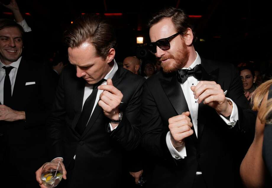 Benedict Cumberbatch, left, and Michael Fassbender attend the FOX after party for the 71st Annual Golden Globes award show on Sunday, Jan. 12, 2014 in Beverly Hills, Calif. Photo: Todd Williamson, Associated Press