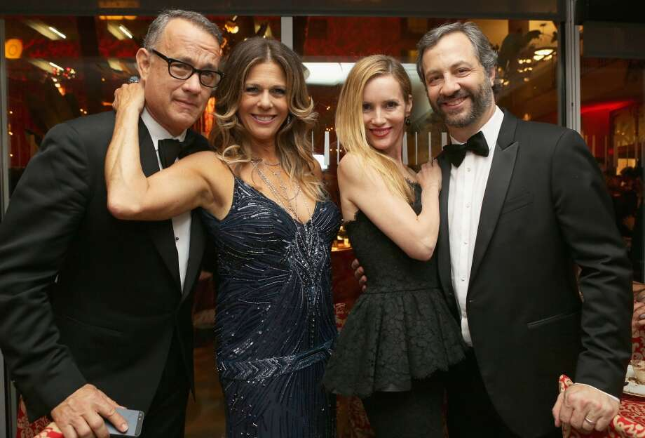 (L-R) Actor Tom Hanks, actress Rita Wilson, actress Leslie Mann, and producer/director Judd Apatow attend HBO's Post 2014 Golden Globe Awards Party held at Circa 55 Restaurant on January 12, 2014 in Los Angeles, California. Photo: Mike Windle, Getty Images