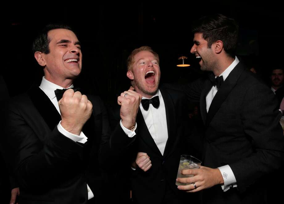 From left, Ty Burrell, Jesse Tyler Ferguson, and Justin Mikita attend the FOX after party for the 71st Annual Golden Globes award show on Sunday, Jan. 12, 2014 in Beverly Hills, Calif. Photo: Todd Williamson, Associated Press