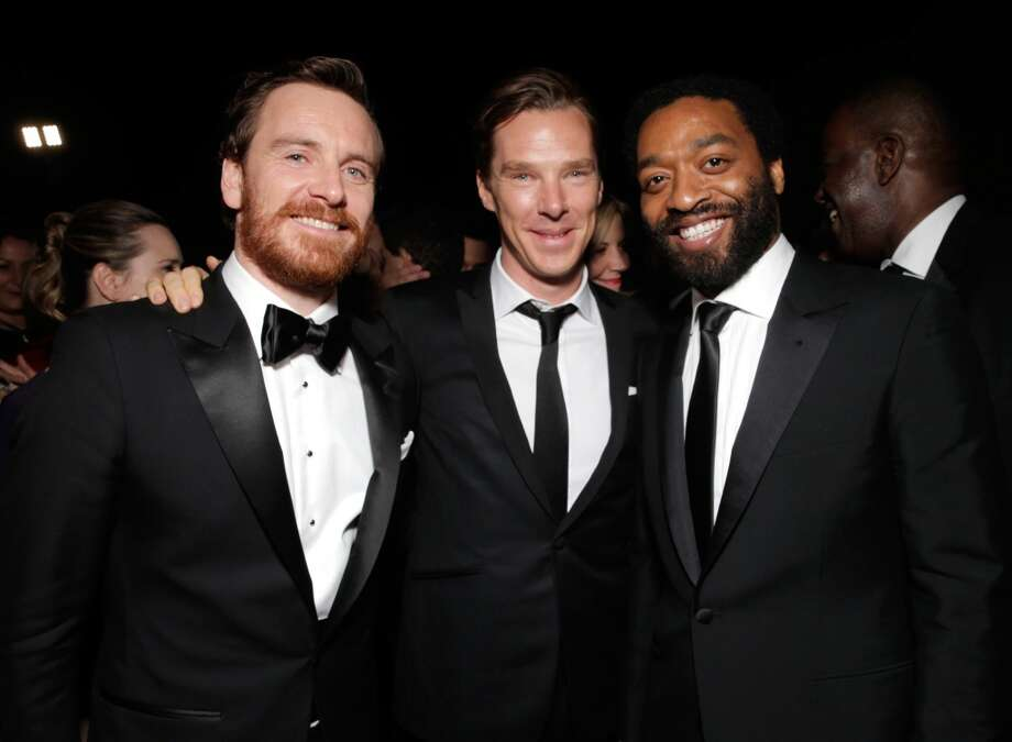 From left, Michael Fassbender, Benedict Cumberbatch, and Steve McQueen winner of Best Motion Picture - Drama for '12 Years a Slave,' attend the FOX after party for the 71st Annual Golden Globes award show on Sunday, Jan. 12, 2014 in Beverly Hills, Calif. Photo: Todd Williamson, Associated Press