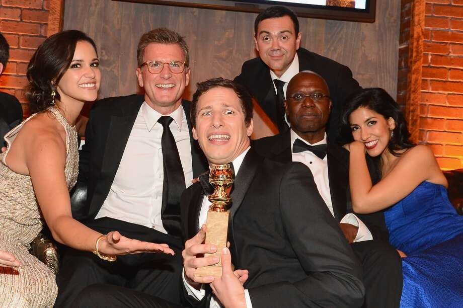 (L-R) Actress Melissa Fumero, Fox Chairman of Entertainment Kevin Reilly, actor Andy Samberg, actor Joe Lo Truglio, actress Stephanie Beatriz, and  actor Andre Braugher attend the Fox And FX's 2014 Golden Globe Awards Party on January 12, 2014 in Beverly Hills, California. Photo: Mark Davis, Getty Images
