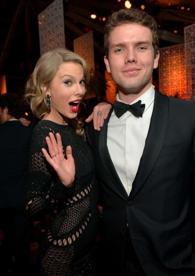 Singer Taylor Swift (L) and her brother Austin Swift attend The Weinstein Company & Netflix's 2014 Golden Globes After Party presented by Bombardier, FIJI Water, Lexus, Laura Mercier, Marie Claire and Yucaipa Films at The Beverly Hilton Hotel on January 12, 2014 in Beverly Hills, California.  (Photo by Charley Gallay/Getty Images for The Weinstein Company) Photo: Charley Gallay, Getty Images For The Weinstein Company)