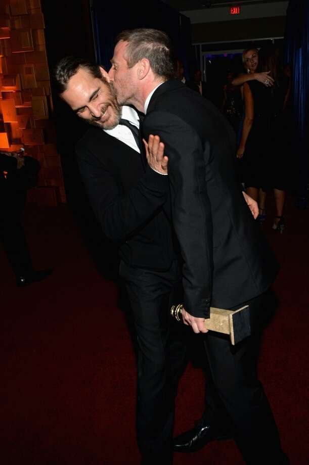 Actor Joaquin Phoenix (L) and director Spike Jonze attend the 2014 InStyle And Warner Bros. 71st Annual Golden Globe Awards Post-Party at The Beverly Hilton Hotel on January 12, 2014 in Beverly Hills, California. Photo: Michael Buckner, Getty Images For InStyle