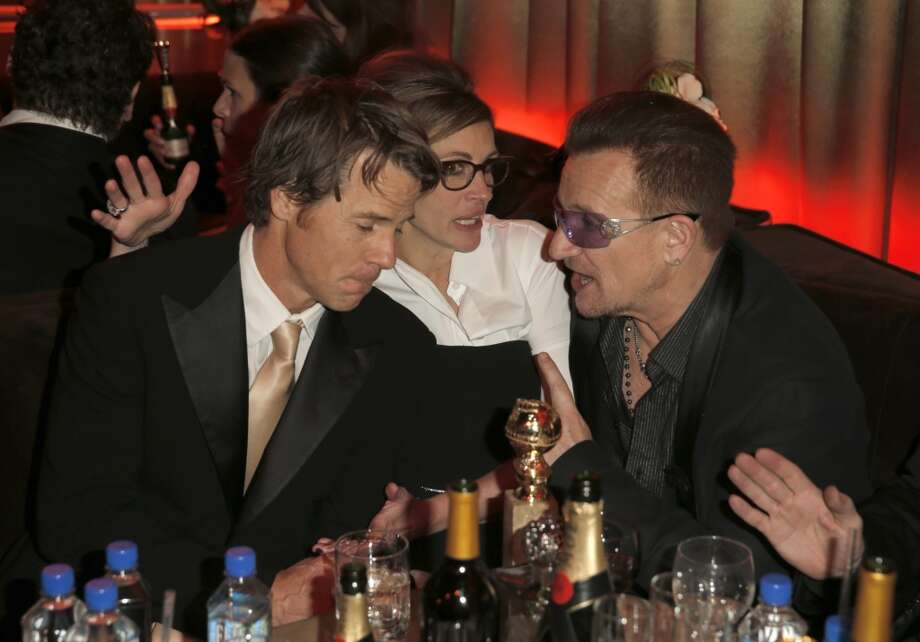 (L-R) Cinematographer Daniel Moder, actress Julia Roberts, and musician Bono of U2 attend The Weinstein Company & Netflix's 2014 Golden Globes After Party presented by Bombardier, FIJI Water, Lexus, Laura Mercier, Marie Claire and Yucaipa Films at The Beverly Hilton Hotel on January 12, 2014 in Beverly Hills, California. Photo: Joe Scarnici, (Credit Too Long, See Caption)