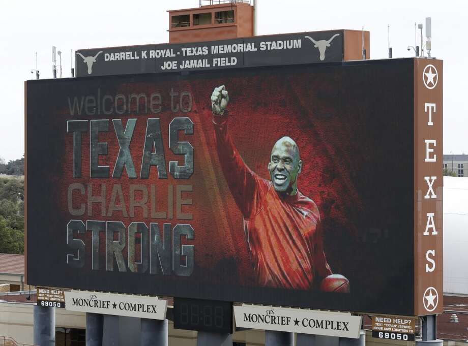 A welcome sign is displayed on the scoreboard at Darrell K Royal–Texas Memorial Stadium for new Texas football coach Charlie Strong on Monday in Austin. Strong replaces Mack Brown, who coached Texas for 16 years and won the 2005 national championship. Strong spent the previous four years at Louisville. Photo: Eric Gay, Associated Press