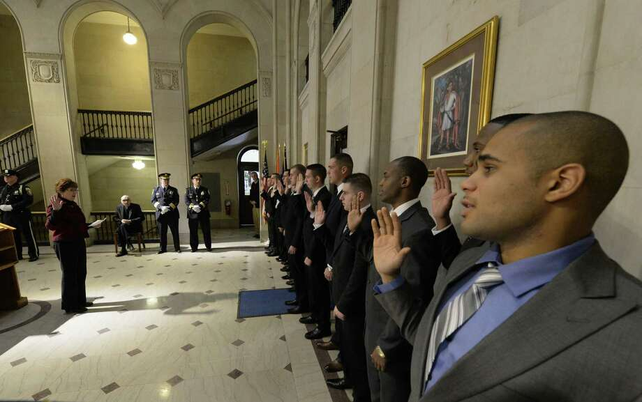 Thirteen new police officers were sworn in by Albany Mayor Kathy Sheehan Monday morning, Jan. 13, 2014, at the rotunda of City Hall in Albany, N.Y.  This was Mayor Sheehan's first recruit class for the Albany Police Department.  (Skip Dickstein / Times Union) Photo: Skip Dickstein / 00025336A