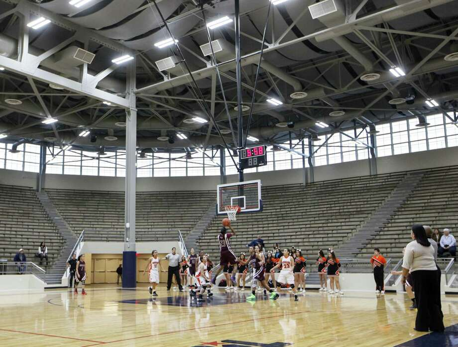 Light pours through the windows at the renovated Alamo Convocation Center last week during the center's inaugural game between Highlands and Burbank. It was the first of a triple-header Jan. 7 at the facility, which was closed for a year and a half as it received millions of dollars in upgrades. Photo: Marvin Pfeiffer / Southside Reporter / Express-News 2014
