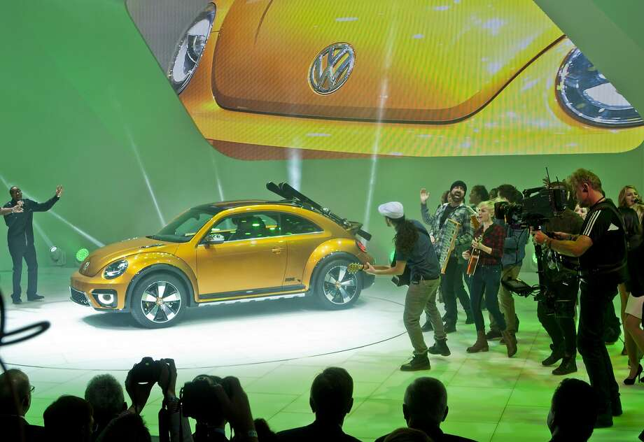 The Volkswagen Beetle Dune concept car is unveiled with performers, Monday, Jan. 13, 2014, at the North American International Auto Show in Detroit. Photo: Tony Ding, Associated Press