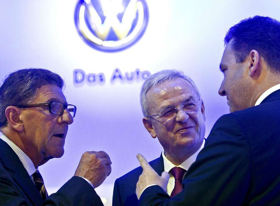 Volkswagen AG Chairman Martin Winterkorn, center, in conversations with colleagues before Volkswagen's press conference, Monday, Jan. 13, 2014, at the North American International Auto Show in Detroit, Mich. Photo: Tony Ding, Associated Press