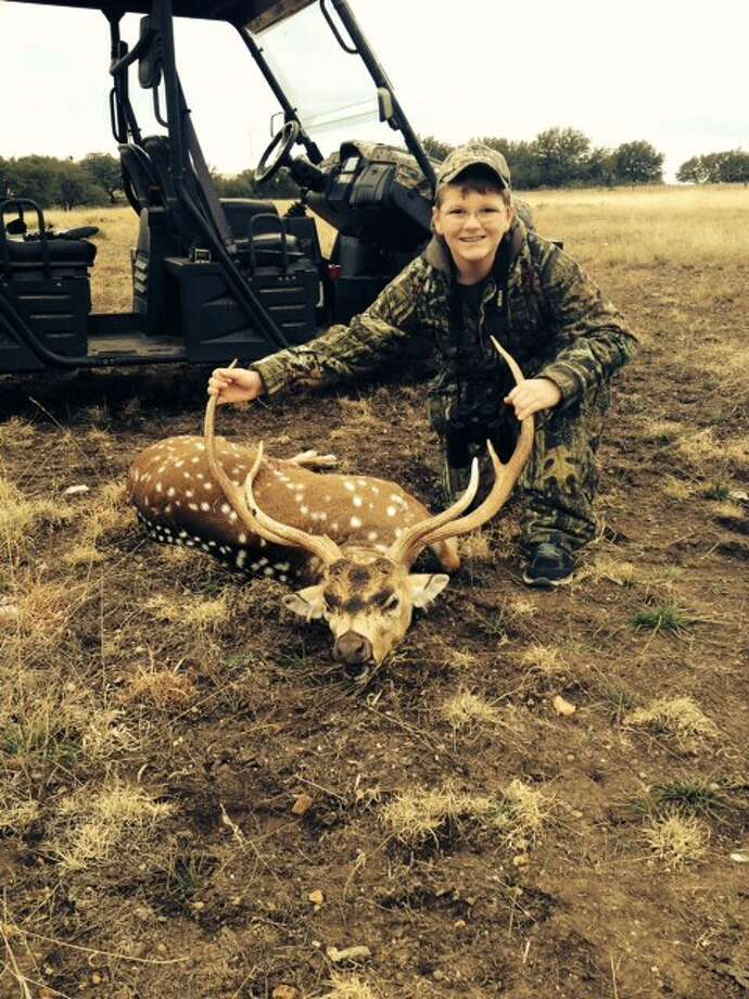 Junah Arimond, age 12, from Spring, killed his first deer on the Mullen Ranch at Mountain Home, Texas, Dec. 28, 2013.