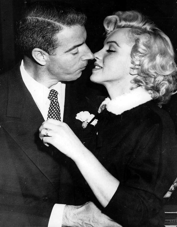 Legendary Hollywood film actress Marilyn Monroe prepares to kiss her husband former baseball player Joe DiMaggio after their wedding in San Francisco. Photo: Popperfoto, Popperfoto/Getty Images / Popperfoto