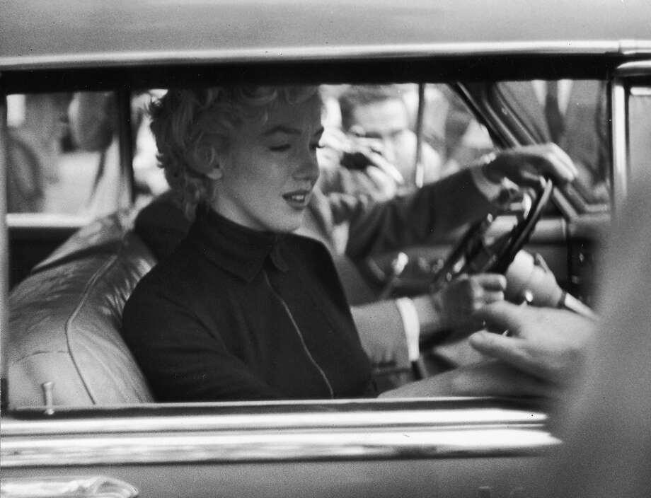 A tearful Marilyn Monroe in the passenger seat of car beside her lawyer Jerry Giesler after announcing her divorce from former baseball great Joe DiMaggio. Monroe was found dead from an overdose of sleeping pills several years later, in 1962. DiMaggio died in 1999. Photo: George Silk, Time Life Pictures/Getty Images / Time & Life Pictures