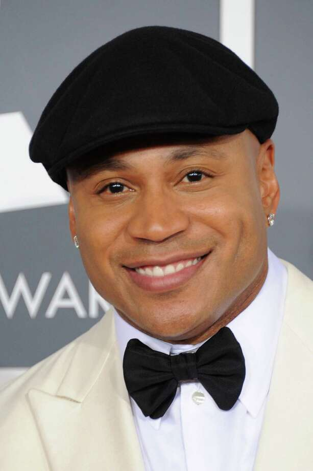 "FILE - In this Feb. 10, 2013 file photo, LL Cool J arrives at the 55th annual Grammy Awards in Los Angeles. Southern white men don't usually drive racial dialogue. For as long as race has riven America, they have been depicted more often as the problem than the solution. So the country music star Brad Paisley must have been unsurprised at the days of widespread criticism of his new song A'A""Accidental Racist,A'A"" which details the challenges facing a A'A""white man from the southlandA'A"" and then features LL Cool J rapping from a black perspective. (Photo by Jordan Strauss/Invision/AP, File) Photo: Jordan Strauss / Invision"
