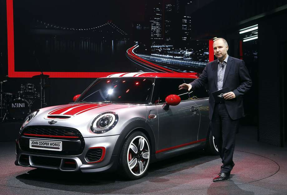 Jochen Goller, senior vice president MINI sales, introduces the MINI John Cooper Works concept is unveiled during media previews during the North American International Auto Show in Detroit, Monday, Jan. 13, 2014. Photo: Paul Sancya, Associated Press