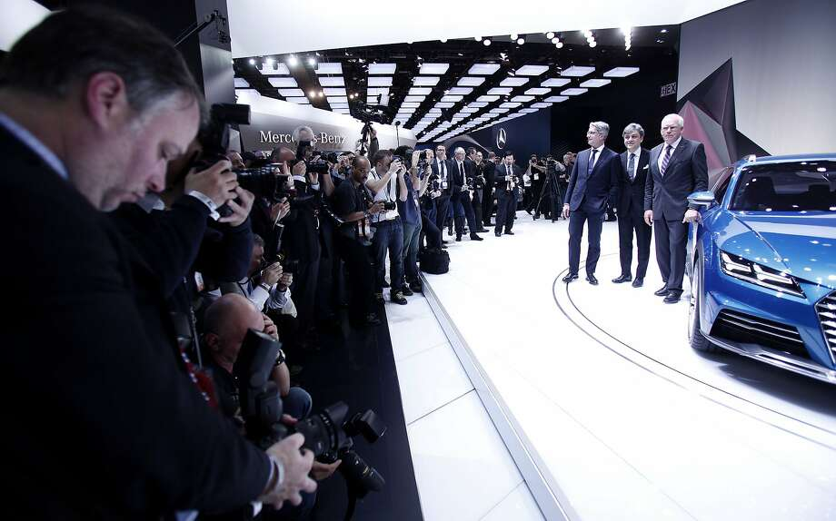 Media photograph Members of the Board of Management  Audi AG posing with the new Audi Offroad Concept vehicle at the press preview of the 2014 North American International Auto Show January 13, 2014 in Detroit, Michigan. Approximately 5000 journalists from more than 60 countries are expected to attend. The 2014 NAIAS opens to the public on January 18th and ends January 16th. Photo: Bill Pugliano, Getty Images