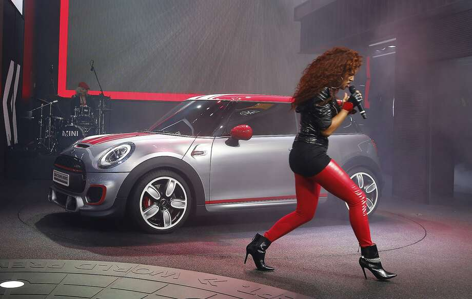 Natalie La Rose sings during as the Mini John Cooper Works concept is unveiled during media previews during the North American International Auto Show in Detroit. Photo: Paul Sancya, Associated Press