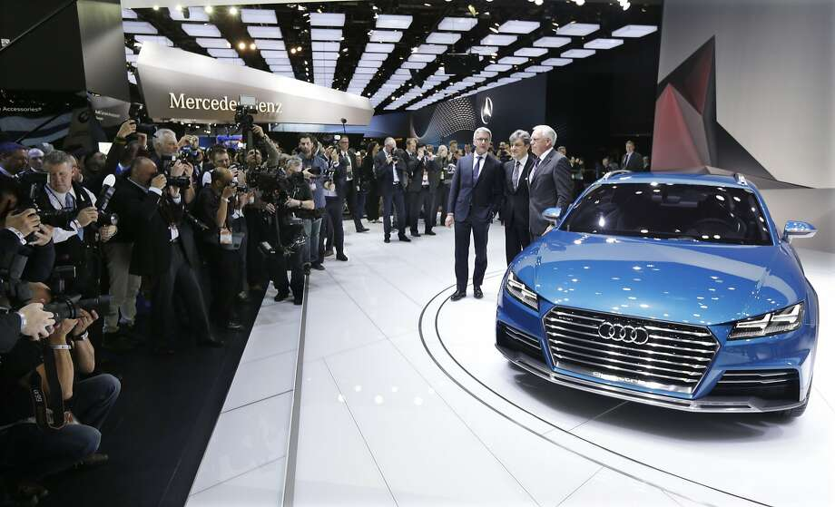 Media gather around the Audi all road shooting brake after its unveiling at the North American International Auto Show in Detroit. Photo: Carlos Osorio, Associated Press
