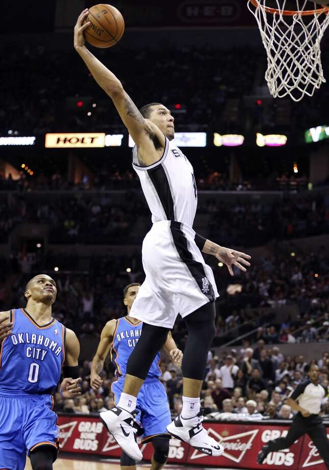 San Antonio Spurs' Danny Green goes up for a dunk around Oklahoma City Thunder's Russell Westbrook during second half action Monday March 11, 2013 at the AT&T Center. The Spurs won 105-93. Photo: Edward A. Ornelas, San Antonio Express-News