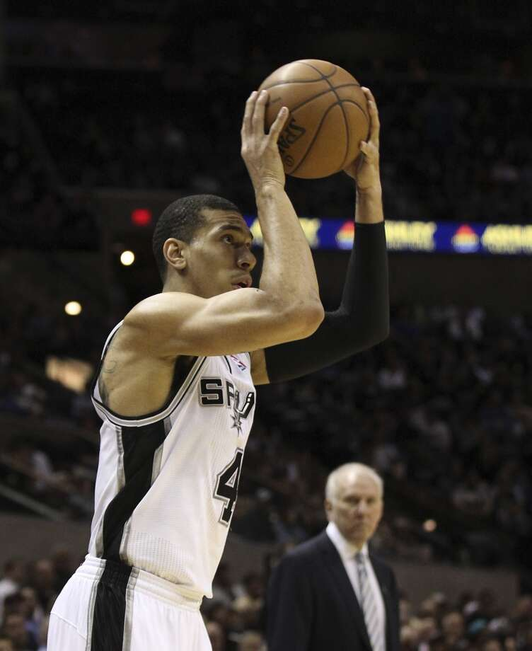 Spurs' Danny Green (04) attempts a three-pointer against the Sacramento Kings in the first half at the AT&T Center on Friday, Mar. 1, 2013. Photo: Kin Man Hui, San Antonio Express-News