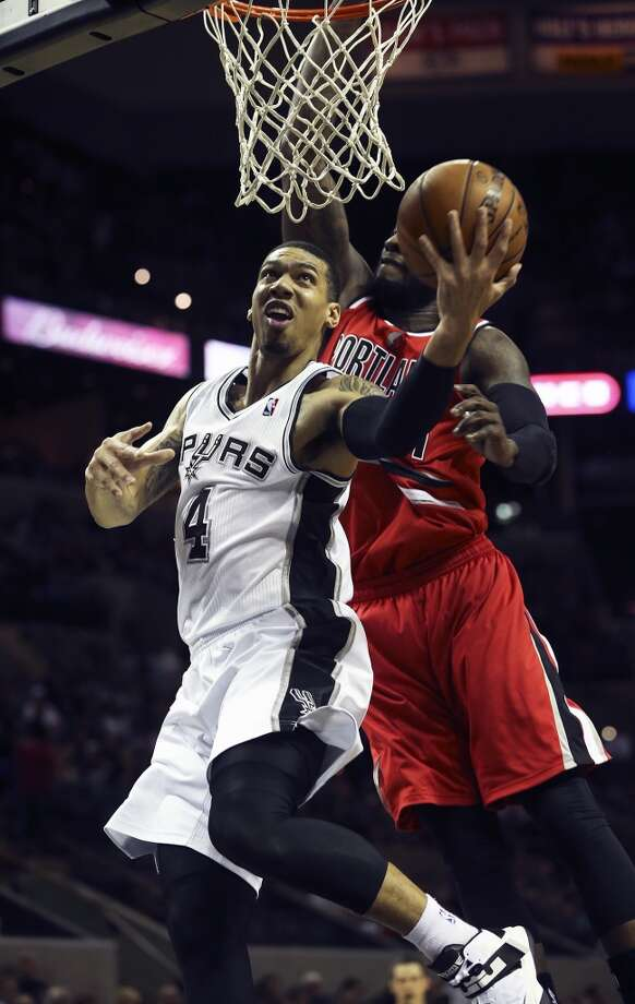 Danny Green gets away from J.J. Hickson in the first half as the Spurs play the Portland Trailblazers at the AT&T Center on March 8, 2013. Photo: TOM REEL, San Antonio Express-News