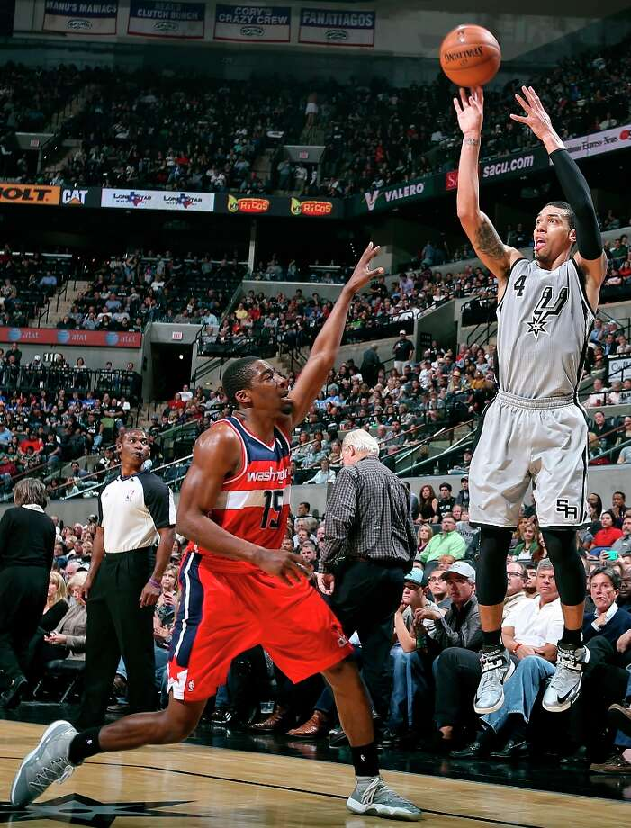 San Antonio Spurs' Danny Green shoots over Washington Wizards' Jordan Crawford during first half action Saturday Feb. 2, 2013 at the AT&T Center. Photo: Edward A. Ornelas, San Antonio Express-News / © 2013 San Antonio Express-News