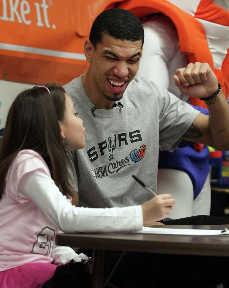 San Antonio Spurs' Danny Green reacts as Howsman Elementary School 3rd grader Sesly Garcia wins a round of Bingo. Green's visit to the school was to acknowledge Garcia's participation in Whataburger's Whatcha Reading program.  Tuesday, Jan. 8, 2013. Photo: Bob Owen, San Antonio Express-News / © 2012 San Antonio Express-News