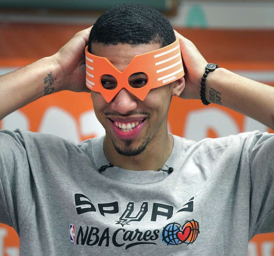 San Antonio Spurs' Danny Green fits on a Whataburger mask as he visits Howsman Elementary School to acknowledge 3rd grader Sesly Garcia's participation in Whataburger's Whatcha Reading program.Tuesday, Jan. 8, 2013. Photo: Bob Owen, San Antonio Express-News / © 2012 San Antonio Express-News